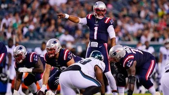Newton, Jones star at QB for Patriots in 35-0 rout of Eagles