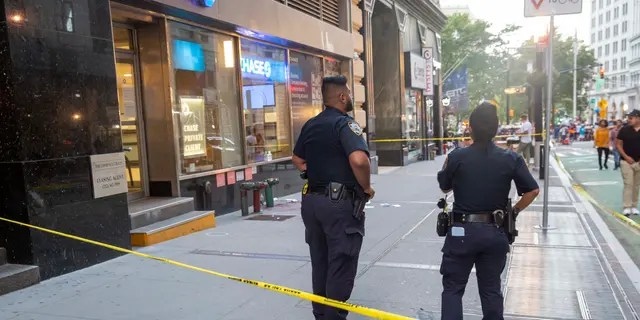 Police at the scene of a hatchet attack.