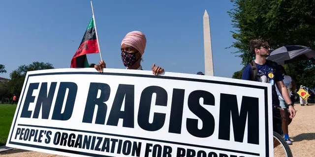 Demonstrators hold up banners during the march for Voting Rights, marking the 58th anniversary of Martin Luther King Jr.'s March on Washington, Saturday, Aug. 28, 2021. In Washington. (AP Photo/Jose Luis Magana)