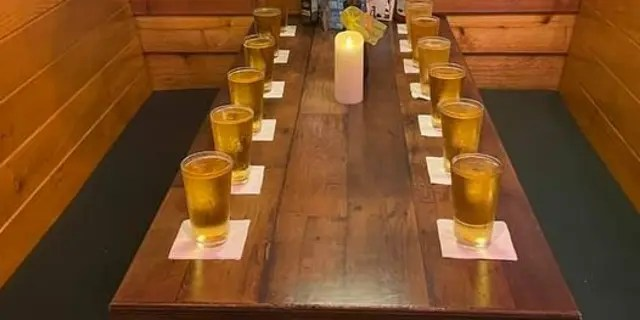 Tyler Scott Parker, the manager of the St. Matthews Texas Roadhouse in Louisville, Ky.,poured out 13 pints and set aside a table for the American service members who were killed in a terrorist bombing outside Afghanistan's Hamid Karzai International Airport.
