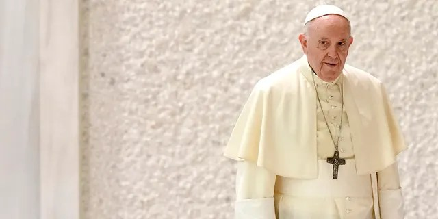 Pope Francis arrives for his weekly general audience in the Paul VI hall, at the Vatican, Wednesday, Sept. 1, 2021. (AP Photo/Andrew Medichini)