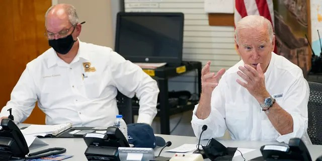 President Joe Biden participates in a briefing about the response to damage caused by Hurricane Ida, at the St. John Parish Emergency Operations Center, Friday, Sept. 3, 2021, in LaPlace, La., as Louisiana Gov. John Bel Edwards listens. (AP Photo/Evan Vucci)
