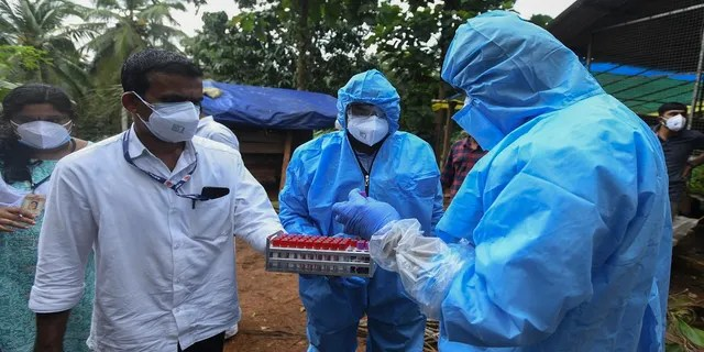 Sept. 7, 2021: Health workers collect blood samples from goats in the neighborhood for testing after a 12-year-old boy died of the Nipah virus in Kozhikode, Kerala state, India.