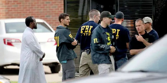 In this Aug. 15, 2017, file photo, law enforcement officials investigate the site of an explosion at the Dar Al-Farooq Islamic Center in Bloomington, Minn.