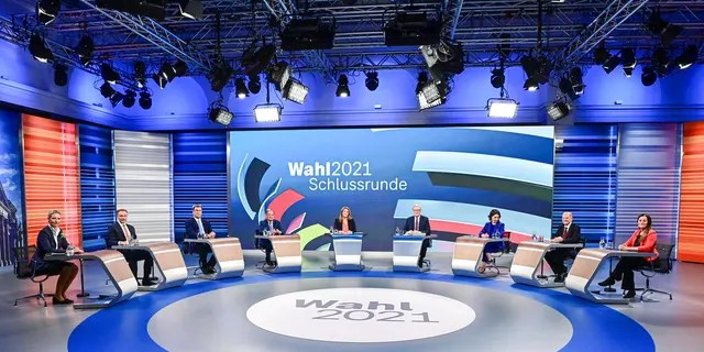 Candidates for the upcoming German election attend a final televised debate in Berlin, Thursday Sept. 23, 2021, ahead of the election on Sunday. From left to 4th left, Alice Weidel, co-leader of the Alternative for Germany party (AfD); Christian Lindner, leader of the Free Democratic Party (FDP); Markus Soeder, Christian Social Union party leader and Bavarian Prime Minister, and Armin Laschet, chairman of the German Christian Democratic Union. From 3rd right to right, Annalena Baerbock, Green Party co-leader; Olaf Scholz, Finance Minister and SPD candidate, and Janine Wissler, co-leader of the left party Die Linke. (Tobias Schwarz/Pool via AP)