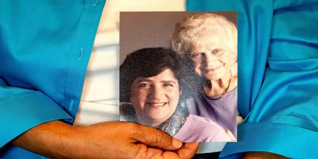 Sept 27, 2021: Dorene Giacopini holds a photo of her with her mother, Primetta Giacopini, from her home in Richmond, Calif.