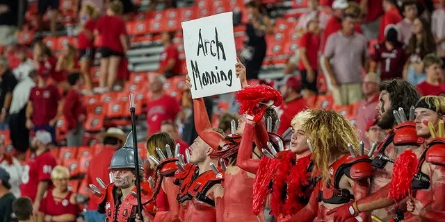 Georgia Bulldogs fans help recruit high school player Arch Manning after Georgia defeated the South Carolina Gamecocks Sept. 18, 2021, at Sanford Stadium in Athens, Ga.