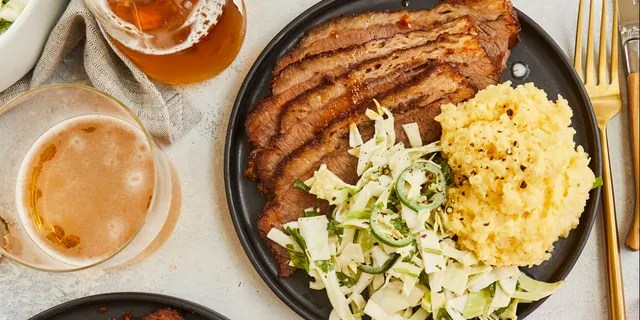 """The Dry-Rubbed Barbecue Brisket with Zesty Cabbage Slaw from Cassy Joy Garcia's new cookbook """"Cook Once Dinner Fix: Quick and Exciting Ways to Transform Tonight's Dinner into Tomorrow's Feast"""" is pictured."""