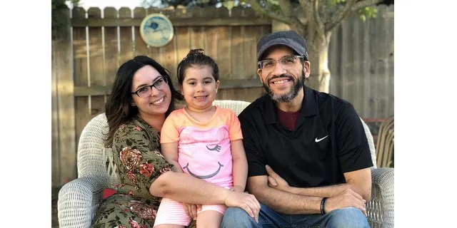 Left-to-right: Kathleen, Sydney and David Lew pose for a family portrait.