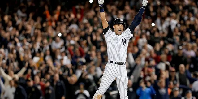 New York Yankees' Derek Jeter jumps after hitting the game-winning single against the Baltimore Orioles in the ninth inning of a baseball game, in New York. The Yankees won 6-5. It was Jeter's last home game of his career at Yankee Stadium.