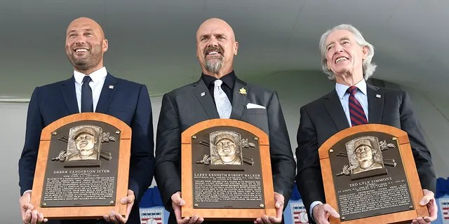 Hall of Fame inductees, from left, Derek Jeter, Larry Walker and Ted Simmons hold their plaques for photos after the induction ceremony at Clark Sports Center on Wednesday, Sept. 8, 2021, at the National Baseball Hall of Fame in Cooperstown, N.Y. (AP Photo/Hans Pennink)