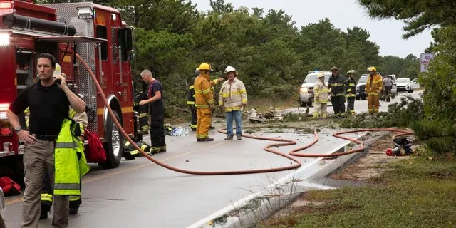 Firefighters at the scene of the crash