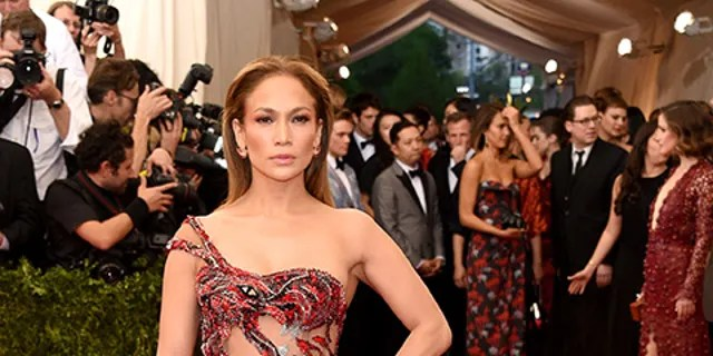 Jennifer Lopez rocked a sheer red dress featuring a dragon at the 2015 Met Gala.