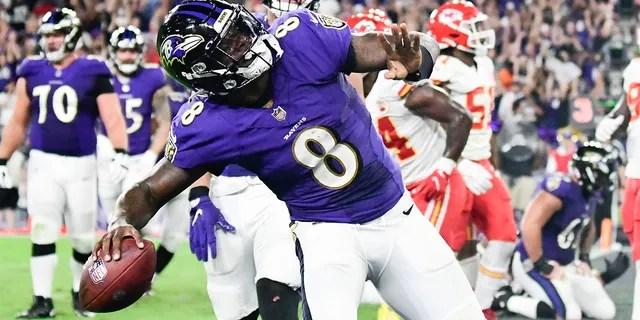 Baltimore Ravens quarterback Lamar Jackson (8) celebrates scoring a fourth quarter touchdown against the Kansas City Chiefs at M&T Bank Stadium.