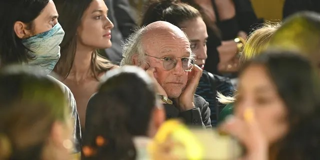 The music during the fashion Shows at Terrace at Spring Studios proved too loud for 'Curb Your Enthusiasm' star Larry David, who is seen using his fingers to plug his ears.