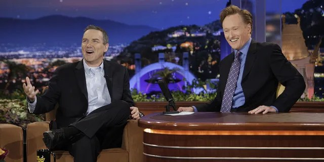 Norm Macdonald was a fan-favorite guest on Conan O'Brien's late-night shows. (Getty Images)