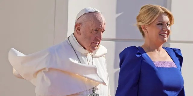 Pope Francis, flanked by Slovakian President Zuzana Caputova, right, attends a welcoming ceremony at the presidential palace in Bratislava, Slovakia, on Monday.