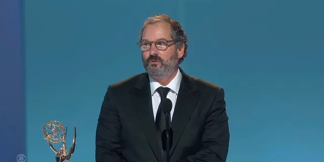 """In this video grab issued Sunday, Sept. 19, 2021, by the Television Academy, Scott Frank accepts the award for outstanding directing for a limited or anthology series or movie for """"The Queen's Gambit"""" during the Primetime Emmy Awards."""