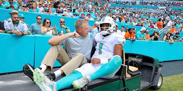 Miami Dolphins quarterback Tua Tagovailoa (1) is assisted off the field during the first half of an NFL football game against the Buffalo Bills, Sunday, Sept. 19, 2021, in Miami Gardens, Fla.