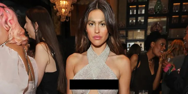 Amelia Gray Hamlin attends the Perfect Magazine and NoMad London Fashion Week party in a sheer dress.