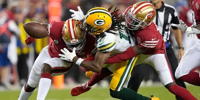 Green Bay Packers wide receiver Davante Adams, center, cannot catch a pass between San Francisco 49ers cornerback Jimmie Ward, left and defensive back Emmanuel Moseley in the second half of an NFL football game in Santa Clara, California, on Sunday, September 26th.  , 2021.