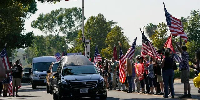 A hearse carrying the body of United States Marine, Lance Cpl. Kareem M. Nikoui makes its way among the main thoroughfare Friday, Sept. 17, 2021, in Norco, Calif. Nikoui along with ten additional Marines, one Navy corpsman and one soldier were killed Aug. 26, 2021, as the result of an enemy attack while supporting evacuation operations outside the Hamid Karzai International Airport Kabul, Afghanistan. (AP Photo/Marcio Jose Sanchez)