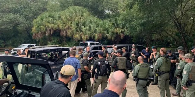 Law enforcement officials conduct a search of the vast Carlton Reserve in the Sarasota, Florida, area for Brian Laundrie on Saturday, Sept. 18, 2021. (North Port Police Department via AP)