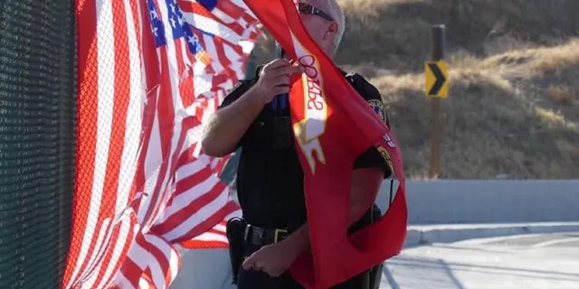 Two citizens helped police to take the flags down and turn them over to a local boy scout troop, police said.