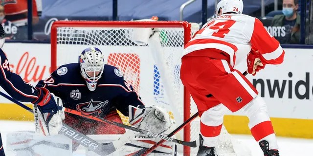 Columbus Blue Jackets goaltender Matiss Kivlenieks (80) makes a save in net against Detroit Red Wings right wing Richard Panik (24) in the overtime period May 8, 2021, at Nationwide Arena in Columbus, Ohio.