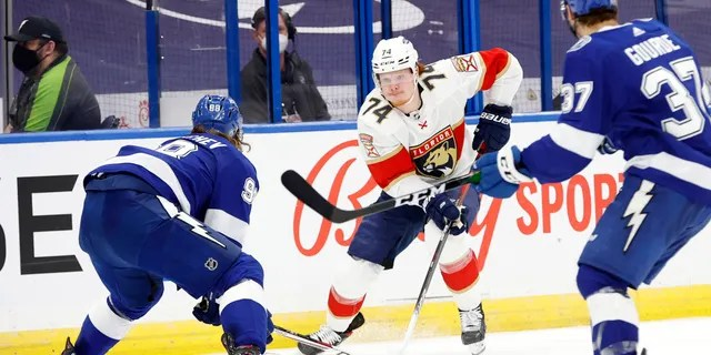 Florida Panthers right wing Owen Tippett (74) skates with the puck as Tampa Bay Lightning defenseman Mikhail Sergachev (98) defends during the second period during game six of the first round of the 2021 Stanley Cup Playoffs on May 26, 2021, at Amalie Arena in Tampa, Florida.
