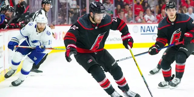 Carolina Hurricanes defenseman Brett Pesce (22) skates with the puck against the Tampa Bay Lightning in game two of the second round of the 2021 Stanley Cup Playoffs June 1, 2021, at PNC Arena in Raleigh, N.C.