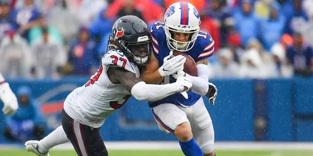 Buffalo Bills wide receiver Cole Beasley (11) runs with the ball as Houston Texans running back Scottie Phillips (27) defends during the second half at Highmark Stadium.