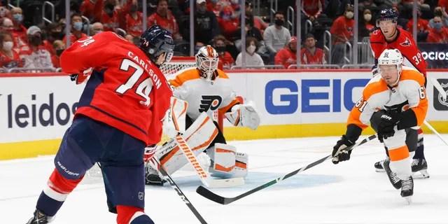 Washington Capitals defenseman John Carlson (74) shoots the puck on Philadelphia Flyers goaltender Martin Jones (35) during the third period Oct. 8, 2021, at Capital One Arena in Washington, D.C.
