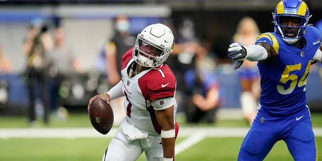 Arizona Cardinals quarterback Kyler Murray, left, avoids the rush from Los Angeles Rams outside linebacker Leonard Floyd during the first half in an NFL football game Sunday, Oct. 3, 2021, in Inglewood, Calif.