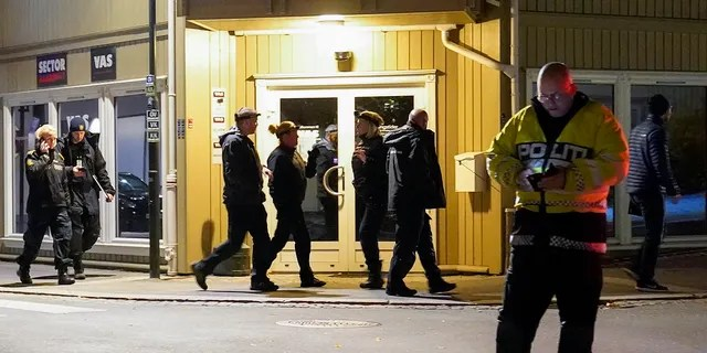 Police work at the scene where an arrow was shot into a wall in Kongsberg, Norway, Wednesday, Oct. 13, 2021. (Torstein Bøe/NTB via AP)