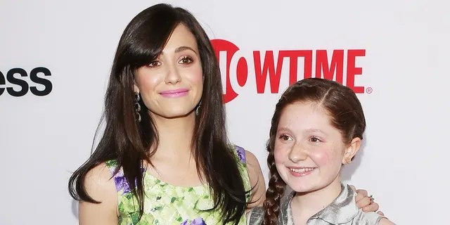 Emma Kenney (right) said that she shared a 'sister relationship' with Emmy Rossum (left), though it had both ups and downs.
