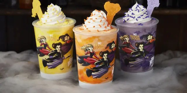 """Carvel's """"Hocus Pocus"""" milkshake trio includes Sarah's Chilling Churro Shake (yellow), Winnie's Glorious Cake Batter Shake (orange) and Mary's Divine Cookies & Cream Shake (purple)."""