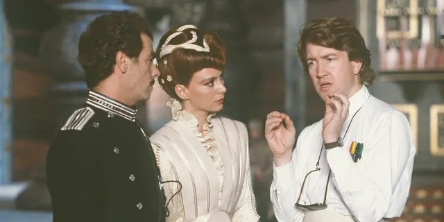American actor Dean Stockwell (left), British actress Francesca Ennis and David Lynch on the set of 'Dune'.