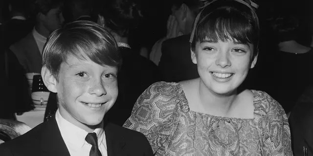 American actor Bill Mumiy and British actor Angela Cartwright, stars of the television show 'Lost in Space', attend the Spotlighters Teen Awards dinner, circa 1966.
