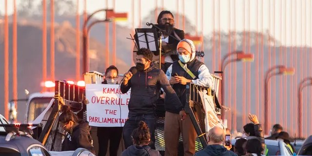 SAN FRANCISCO, CA - SEPTEMBER 30: Protesters block northbound traffic on the Golden Gate Bridge in San Francisco, CA. Thursday, September 30, 2021 during a demonstration demanding Congress grant a pathway to citizenship for the country's 11 million undocumented people. (Jessica Christian/The San Francisco Chronicle via Getty Images)