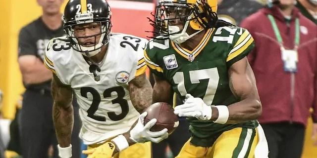 Green Bay Packers wide receiver Davante Adams (17) catches a pass against Pittsburgh Steelers cornerback Joe Haden (23) in the third quarter at Lambeau Field.