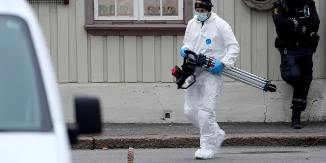 Police work near a site Thursday after a man killed some people in Kongsberg, Norway.