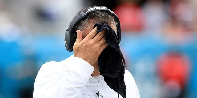 Head coach Urban Meyer of the Jacksonville Jaguars wipes his face with a towel during the game against the Denver Broncos at TIAA Bank Field on Sept. 19, 2021, in Jacksonville, Florida.