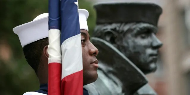 WASHINGTON, DC - SEPTEMBER 17: A member of the Navy Ceremonial Guard stands for the national anthem during a ceremony for National POW/MIA Recognition Day, at the U.S. Navy Memorial on September 17, 2021 in Washington, DC. The ceremony honored all military personnel who were prisoners of war or who are still missing in action. (Photo by Kevin Dietsch/Getty Images)