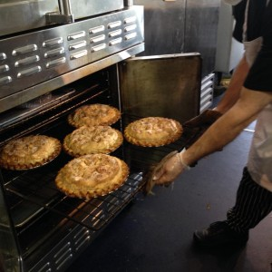 Our baker Marty pulls 5 apple pies from the oven