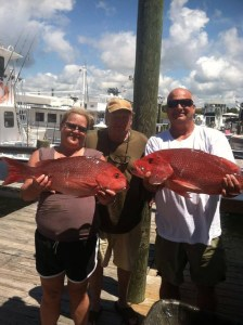 Orange Beach semi-private fishing charter couple with red snapper catch
