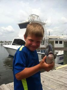 Young angler with a big smile with his triggerfish along the AL gulf coast