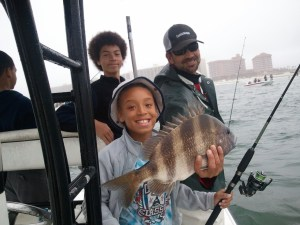 young angler with a big smile & a sheepshead Spring Break 2015