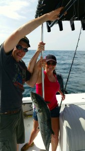 TX anglers deep sea fishing reeling in big king mackerel on the AL Gulf Coast