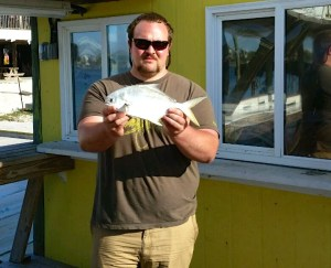 MI angler with a pompano He travel to AL for an inshore fishing charter with Captain John